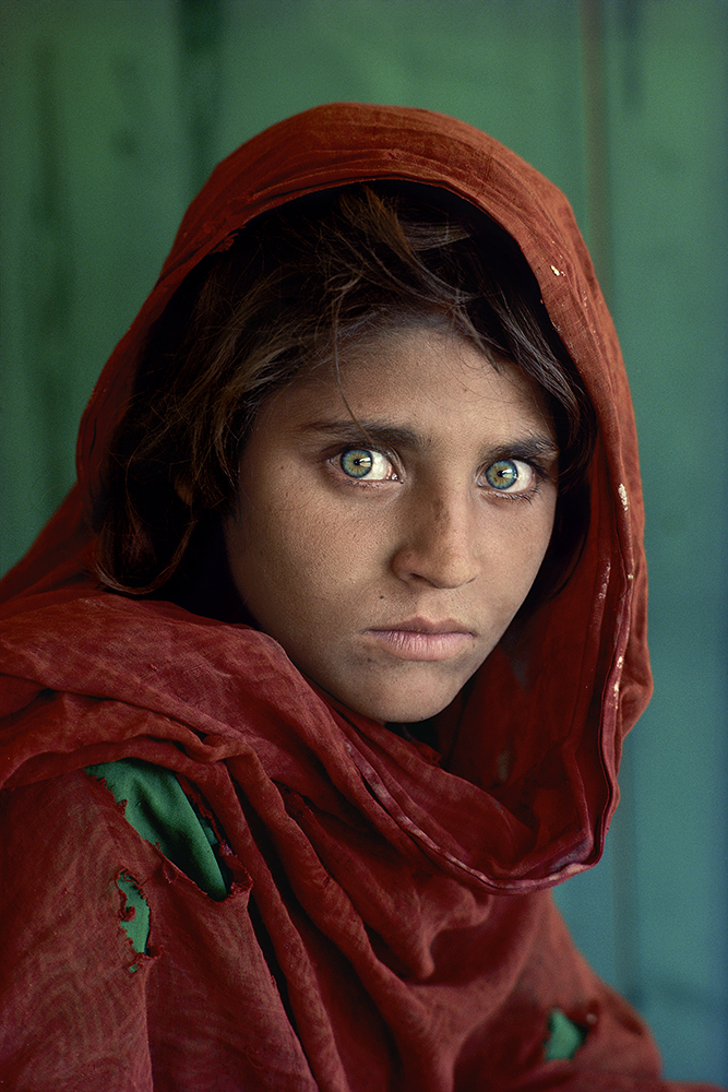 "Sharbat Gula, Afghan Girl, at Nasir Bagh refugee camp near Peshawar, Pakistan, 1984.  MAX PRINT SIZE: 40x60  Sharbat Gula, the Afghan Girl, at Nasir Bagh refugee camp near Peshawar, Pakistan, 1984 -Untold (pg. 81)  National Geographic Magazine, Vol. 167, No. 6, June 1985, Along Afghanistan's War-torn Frontier.  ""The green-eyed Afghan girl became a symbol in the late twentieth century of strength in the face of hardship.  Her tattered robe and dirt-smudged face have summoned compassion from around the world;  and her beauty has been unforgettable.  The clear, strong green of her eyes encouraged a bridge between her world and the West.  And likely more than any other image, hers has served as an international emblem for the difficult era and a troubled nation."" - Phaidon 55  The iconic image does not stand outside of time.  Rather, it connects with the moment in a deeply profound way.  Such as images are imbued with meaning, a significance that resonates deeply with a wide and diverse audience.  McCurry's photograph of the Afghan girl is one such image.  For many, this beautiful girl dressed in a ragged robe became a worldwide symbol for a nation in a state of collapse.    Haunted eyes tell of an aAfghan refugee's fears.   --  Bannon, Anthony. (2005). Steve McCurry. New York: Phaidon Press Inc., 12.  NYC5958, MCS1985002 K035  Afghan Girl: Found National Geographic, April 2002  Phaidon, Iconic Images, final book_iconic, page 33.  National Geographic Magazine, Along Afghanistan's War-torn Frontier, June 1985, Vol. 167, No. 6  South Southeast_Book In the Shadow of Mountains_Book Steve Mccurry_Book Looking East_Book Iconic_Book Untold_book PORTRAITS_APP final print_MACRO final print_Sao Paulo  final print_Milan  final print_Birmingham  Fine Art Print final print_HERMITAGE final print_Zurich final print_Ankara Retouched_ Sonny Fabbri 03/04/2015"